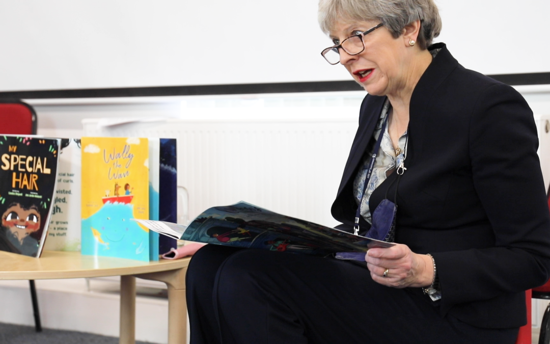Theresa May reads to Think Equal class